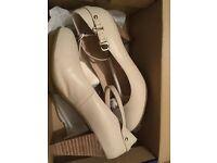 White high heeled shoes