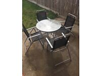 Garden table and 4 chairs - will consider sensible offers