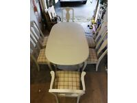 Table and chairs with queen Anne legs