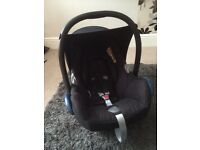 Maxi cosi carbrofix car seat, sunhood and raincover.