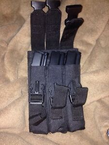 3 airsoft mp5 magazines and a pouch