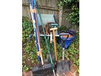 Garden tools and wheelbarrow