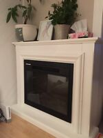 White Electric fireplace , hardly used.