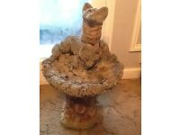 Stone fox bird bath garden ornament