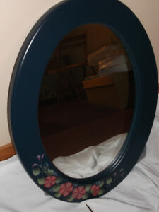 Blue toll painted wall mirror with painted flowers