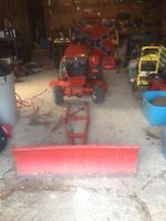Toro wheel horse with plow, cutting deck, pull dethatcher
