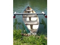 Canoe with 2 new paddles + 2 new life jackets
