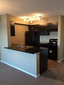 2 BEDROOM CONDO - AIRDRIE - FEBRUARY FREE!!