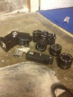 Canon ae-1 with lenses, winder, flash