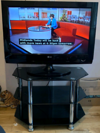 LG 32 inch TV with glass stand