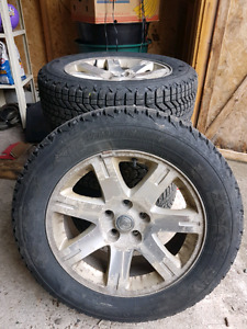 Set of Firestone Winterforce studded winter tires on rims