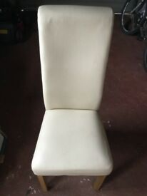 4 cream leather chairs