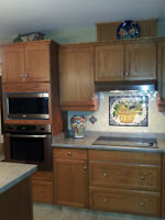 Oak kitchen cabinets, and countertops