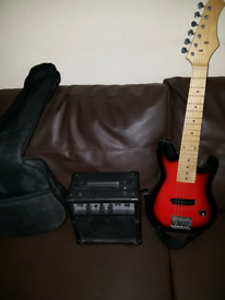 Kids guitar and amplifier