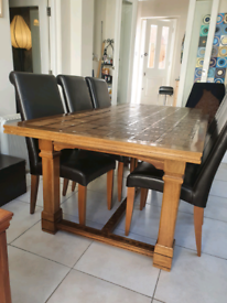 Wooden dining table and leather chairs