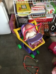 Shopping cart with doll