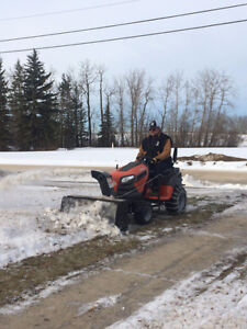Riding mower with snow blower attachment