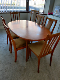 Extending oak dining table + chairs
