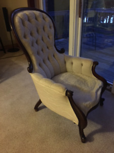 Antique Queen Ann chair. Dark wood with cream upholstery.