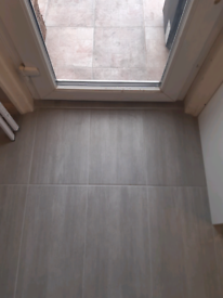 Grey tiles for floor or wall.