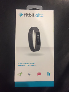 Black Fitbit Alta and Extra Teal Band