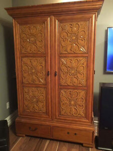 Large hand carved wardrobe or entertainment unit