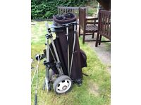 Set of left handed golf clubs with trolley and bag