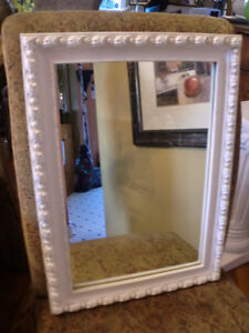 Antique mirror - 16 inches by 22 (carved wooden frame - roses)