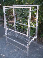 Vintage rolling metal cot in West Kelowna