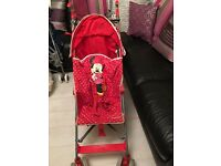 Minnie Mouse buggy with brand red sun parasol