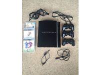 PlayStation 3 (40GB) + 3 games