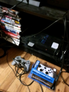PS2 2 Controllers and 20 games