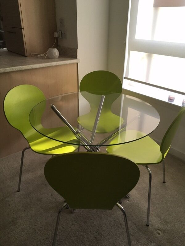 Chrome/glass dining set and 4 lime chairsin GlasgowGumtree - Dining set in excellent condition and hardly used. Table diameter 90cm. Cost £180 new
