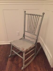 Distressed antique wood small rocking chair