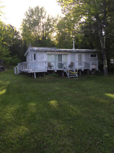 Highly sought after camp and property Havilland Shores Drive.