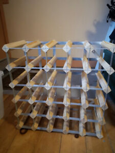 wood and metal wine rack for 25 bottlers