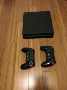 PS4(500gb) with 2 controllers and 18 games for sale