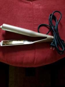 Brand New Hot Curling Iron.