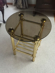 A   VINTAGE GLASS TOP BRASS LEGS TABLE FOR SALE