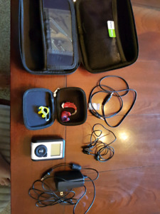 Mint Phonak hearing aid with Oticon transmitter/receiver