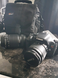 Cannon T3i DSLR with 55-250mm extra lense
