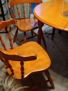 Round Wood Kitchen Table with Two Captain Chairs