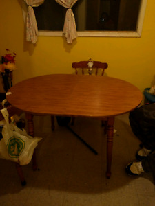 Table and chair set includes 4 chairs