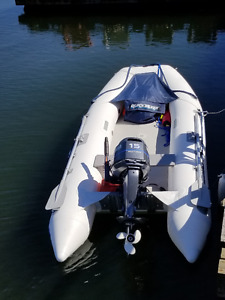 """Quicksilver Inflatable 11'2"""" with 15 HP Yamaha 25 hours"""