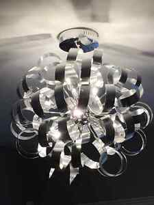 Light - contemporary curled brushed metal