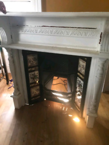 Antique cast iron fireplace insert and mantle.