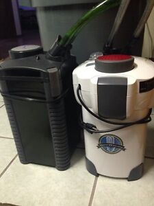 2 canister filters for sale each have 3 trays with hoses