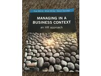 Managing in a business context book