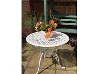 Lovely vintage garden bistro table. While.