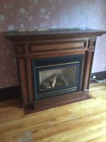 Two natural gas/propane fireplace (one sold, one left)